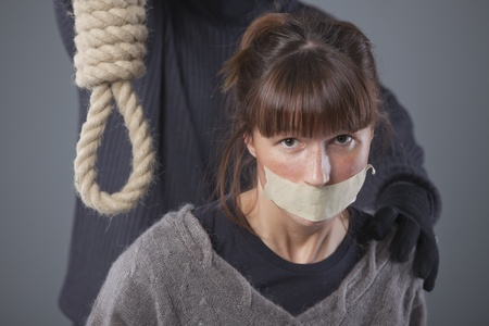 kidnapped woman and hangman with noose over grey background photo