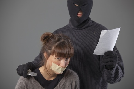 armed hijacker with ransom demand and female hostage Stock Photo - 8905485
