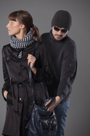 man pulls wallet out of a woman handbag Stock Photo - 8905565