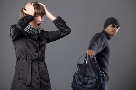 man mugs woman and steals her handbag Stock Photo - 8905492