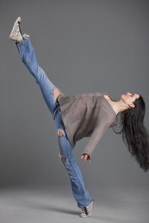 female hip hop dancer over grey background photo