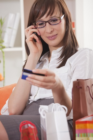 home shopping - woman with credit card ordering  photo