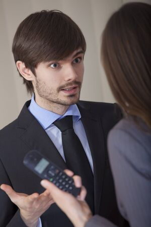 angry discussion in office between man and woman photo