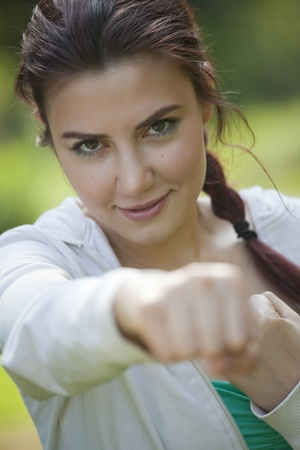 young fitness woman doing punching exercises outdoors Stock Photo - 9575240