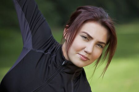 Fitness woman doing stretching exercises outdoor in the park Stock Photo - 9575227