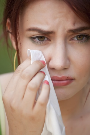 portrait of young crying woman with handkerchief Stock Photo