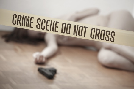 unconscious: crime scene - nude dead woman with gun lying on the ground