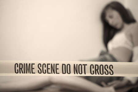hostage: crime scene - abused woman playing dead on the ground