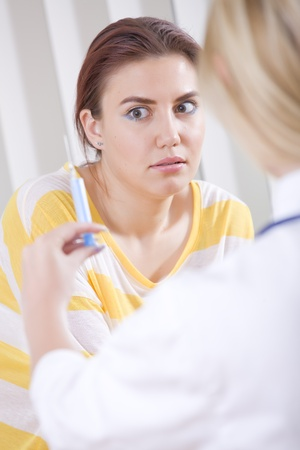 female patient has fear of syringe injection photo