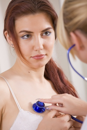 female doctor checkup with stethoscope a young woman Stock Photo - 10066855