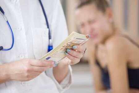 paying cash for medical treatment - focus on money photo