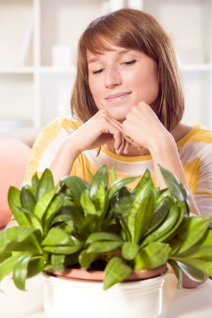 young happy woman looking at plants