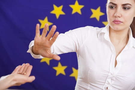 begging hand to european union and rejecting or stop gesture from a young woman photo