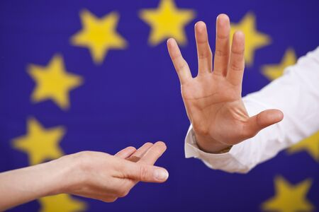 begging and rejecting hand over european flag