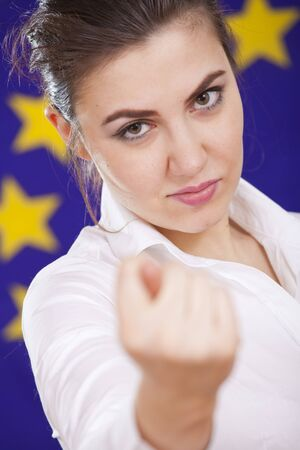 conceptual scene - woman showing fig gesture over european union flag photo