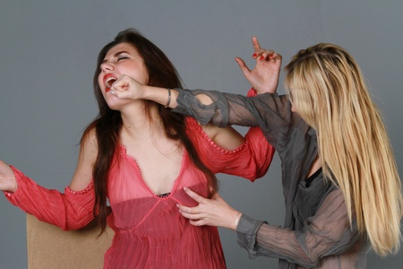 two women fighting - painful face punch photo