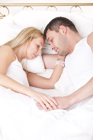romantic couple in nightwear sleeping in bed photo