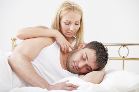 Romantic couple lying in bed photo