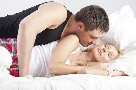Couple in Love - man kissing sleeping woman Stock Photo - 13136096