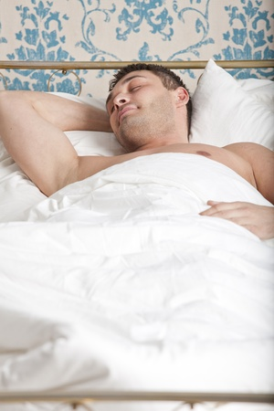 portrait of a man sleeping in bed Stock Photo - 13135872