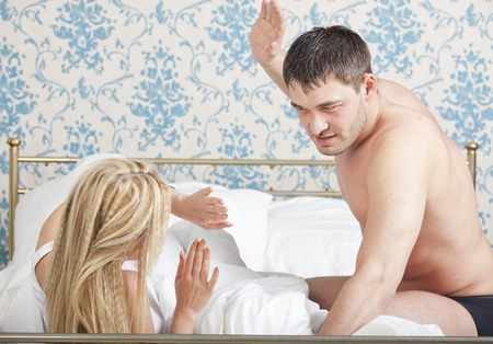beaten woman: couple problem - domestic violence or abuse Stock Photo