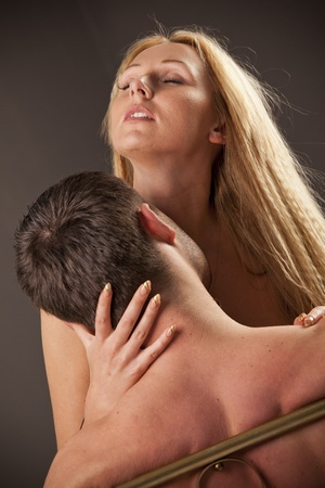 young couple making love in bed Stock Photo