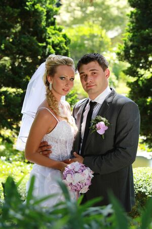 Classic portrait of wedding couple in the park photo
