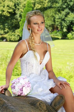 thee: Portrait of Bride sitting on a thee in the park