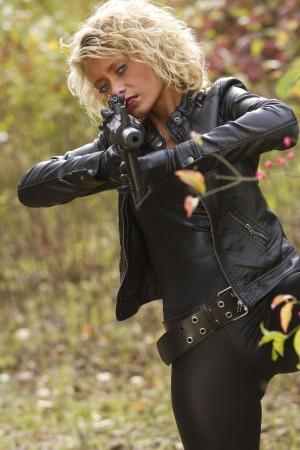 silencer: Woman with machine gun Stock Photo