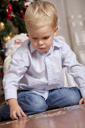 Boy playing with puzzle at christmas photo