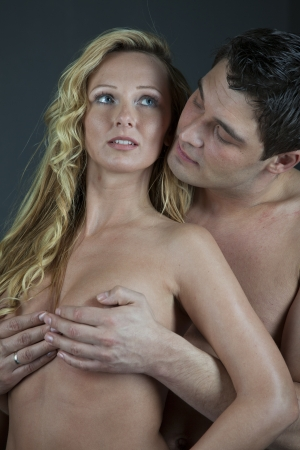 Romance - Naked couple embracing over grey background Stock Photo - 17818086