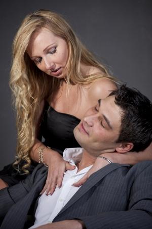 Portrait of passionate couple in studio over grey