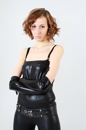 Leather clad woman over white background