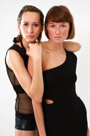 portrait of two women over white background photo