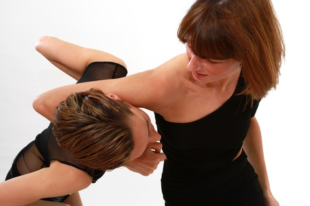 grappling: conflict between two women over white background Stock Photo