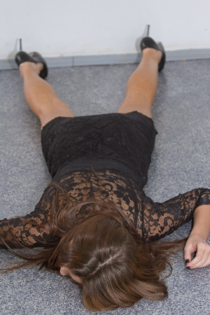 killings: Crime scene - young woman in short dress playing dead on the ground