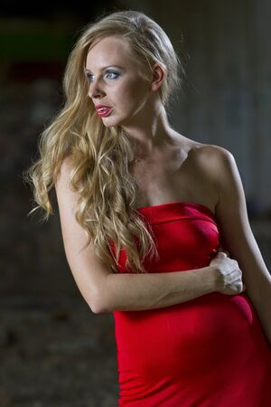 red evening: Woman in red evening dress posing outdoor