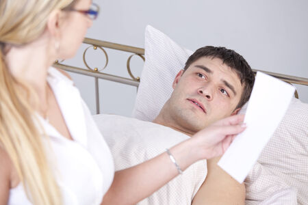 Shocked man on bed after a diagnostic report  photo