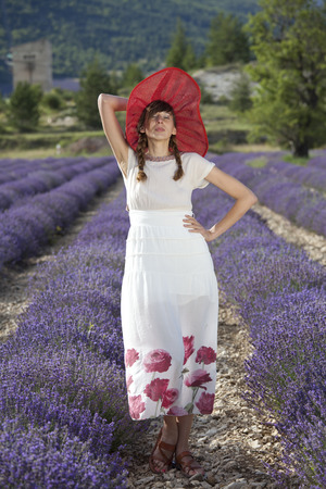 happy woman in a white dress posing in a lavender field. photo