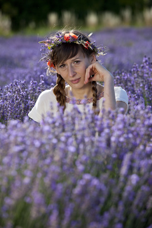 woman in a white dress sitting and relaxing in a lavender field. photo
