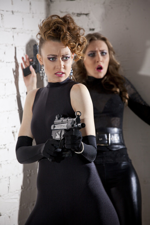 Two female spies acting shootout