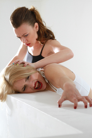 female wrestling: Two women fighting on the stairs