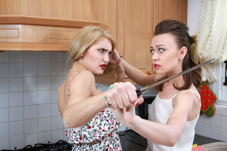 female domination: Two women fighting in the kitchen over kitchen knife