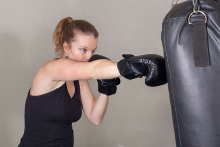 strong toughness: Young blonde woman in a boxing gym for a workout