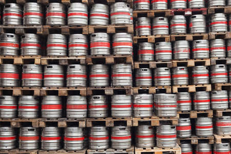 steel drum: Barrels of beer stacked on top of pallets in the factory
