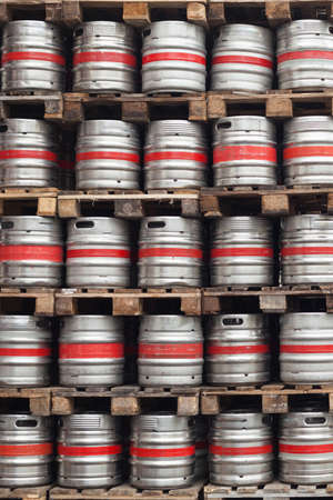 barrel tile: Barrels of beer stacked on top of pallets in the factory
