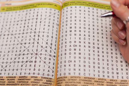responsibility survey: puzzle of the letters in a book filled pen Stock Photo
