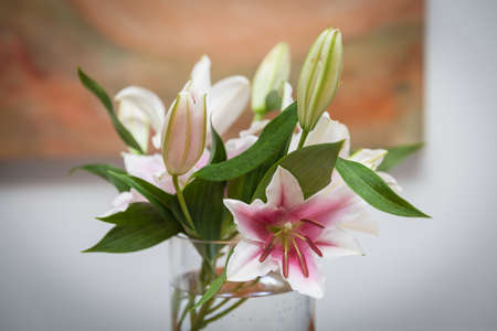 Lilies In A Vase To Decorate The Kitchen Table In The House Stock