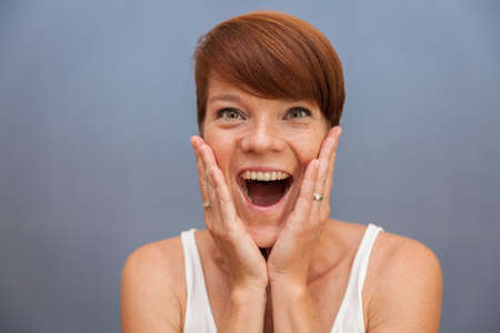 young beautiful woman anticipates emotions: joy, sadness, excitement, fear, surprise, shame, anger