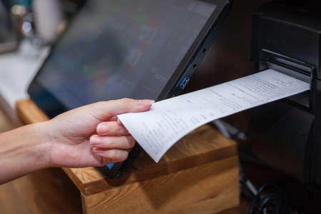 Touchscreens cash register in the restaurant and commerce store